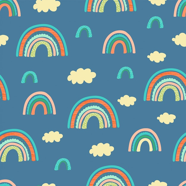 Seamless pattern with rainbow, clouds and hand letters focus on the good for kids Premium Vector