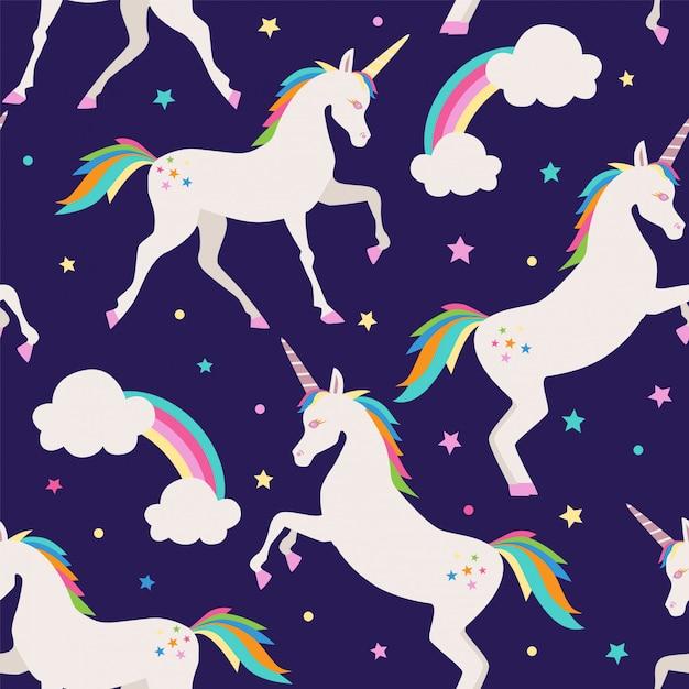 Seamless pattern with rainbow and unicorns. Premium Vector
