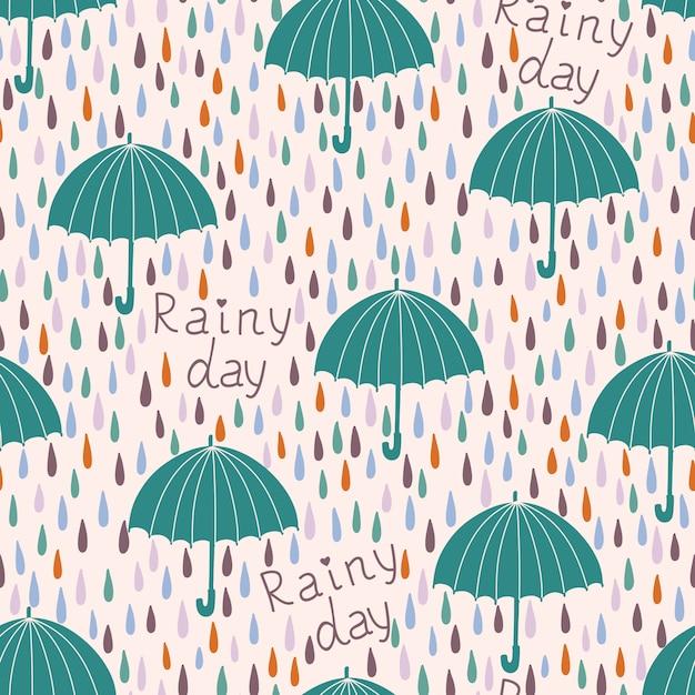 雨と傘とのシームレスなパターン。春の背景 Premiumベクター