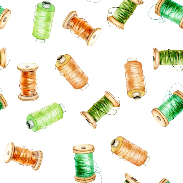 Seamless pattern with watercolor green and orange spools of thread Premium Vector