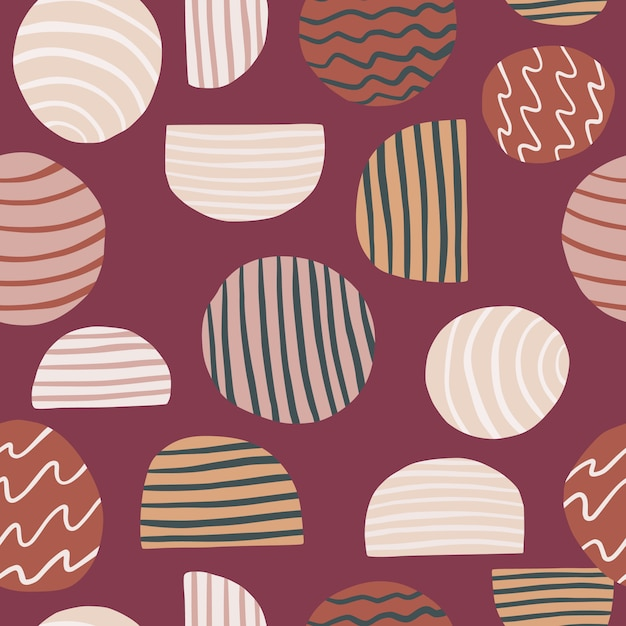 Seamless patttern with abstract elements. circles and halfs ornament on soft maroon background. Premium Vector