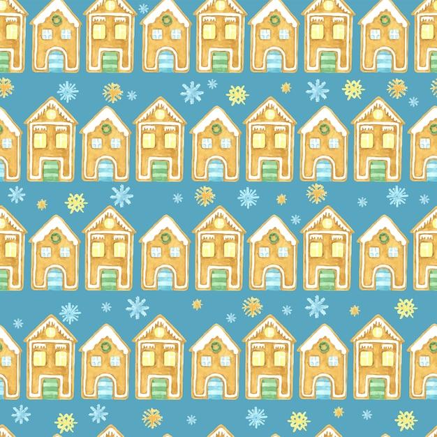 シームレスな冬のパターン。クリスマスの水彩画のデザイン。手描きのジンジャーブレッドハウスと雪片 Premiumベクター