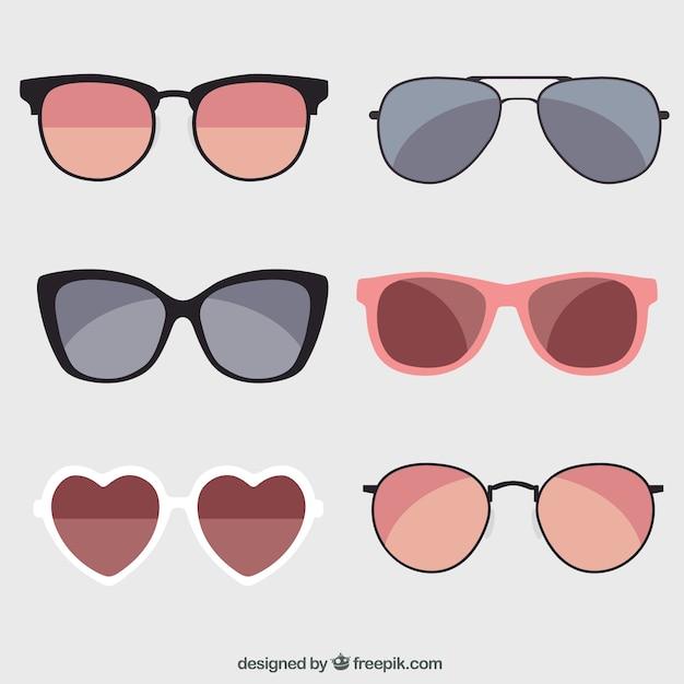 Seasonal sunglasses collection in flat syle Premium Vector