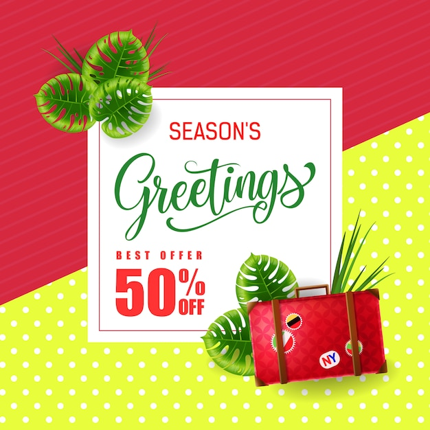 Seasons greetings lettering with luggage bag\ and tropical leaves.