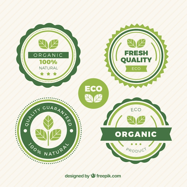 Selection of round labels with green leaves Free Vector