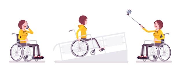 電話、selfieカメラ、ランプ上の女性の若い車椅子ユーザー Premiumベクター