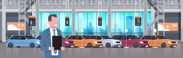 Seller man in cars dealership center showroom interior over set of new modern vehicles horizontal illustration Premium Vector
