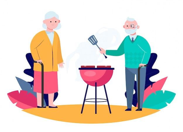 シニアカップルが庭でバーベキュー肉を調理 無料ベクター