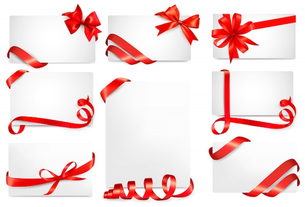 Set of beautiful gift with red gift bows with ribbons Premium Vector
