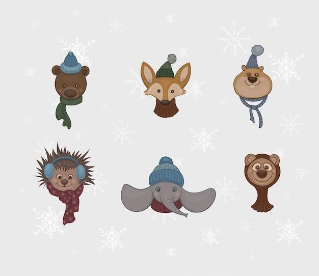 Set of cartoon cute animals in warm scarfs and caps Premium Vector