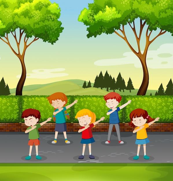 Set of children dabbing in park Premium Vector