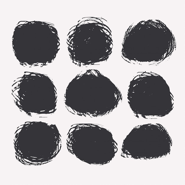 Set of circular grunge or paint stains Free Vector