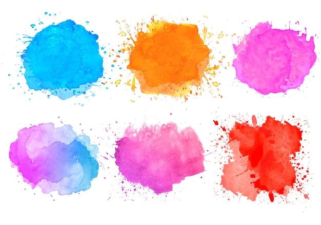 Set di coloratissimi schizzi ad acquerello macchia design Vettore gratuito