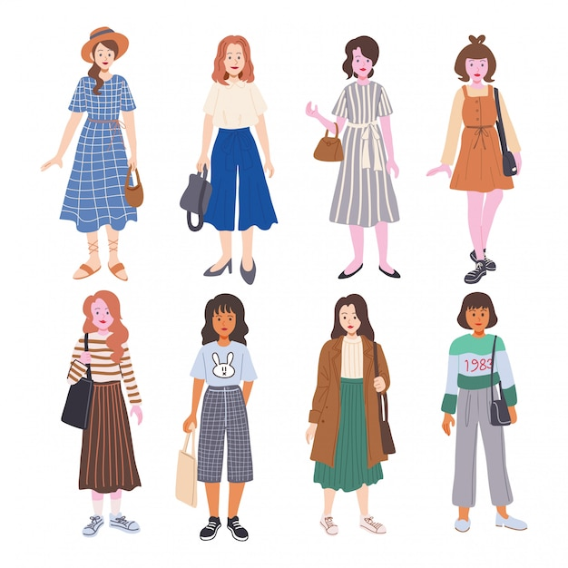 Set of cute young woman dressed in trendy clothes Premium Vector