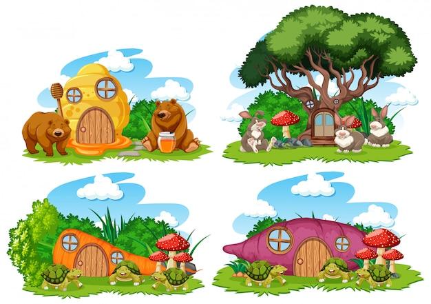 Insieme delle case di fantasia nel giardino con simpatici animali isolati su sfondo bianco Vettore gratuito