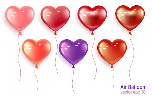 Set of festive balloons in the shape of a heart. Premium Vector
