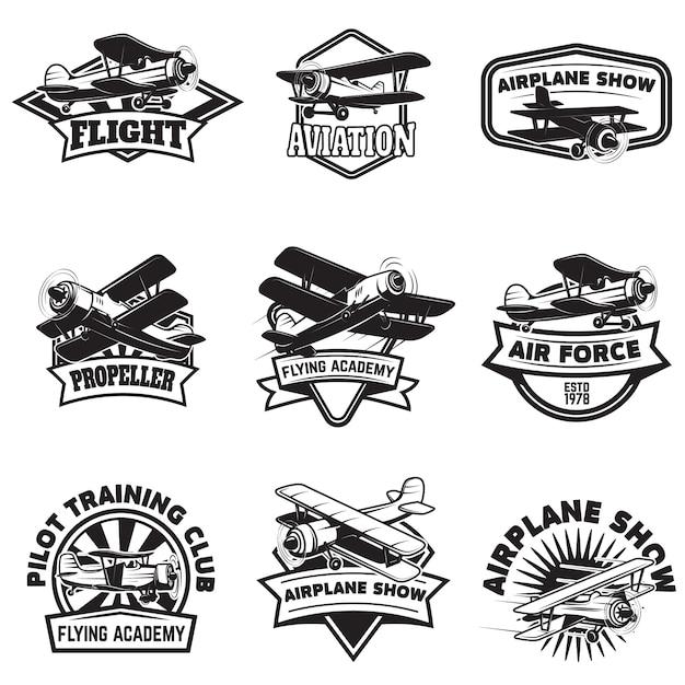 Set of flying academy emblems. vintage airplanes.  elements for logo, label, emblem, sign.  illustration. Premium Vector