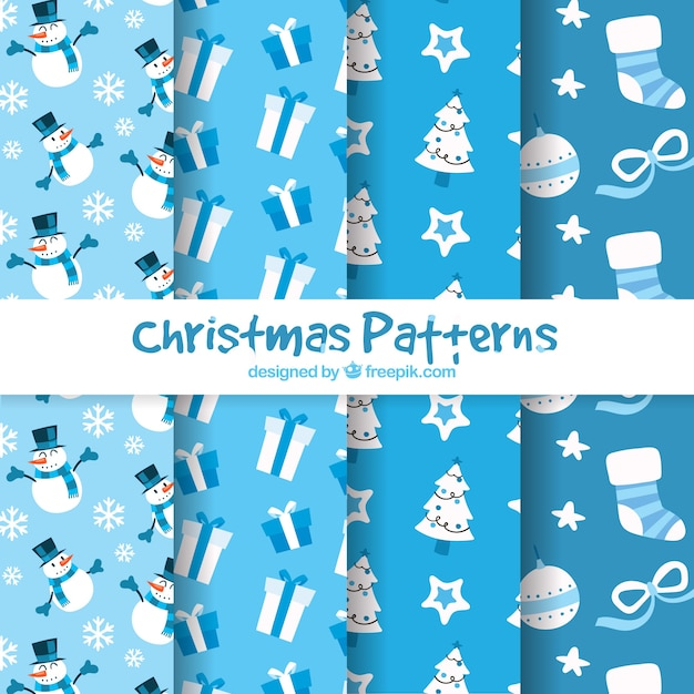 Set of four christmas patterns in blue tones Free Vector