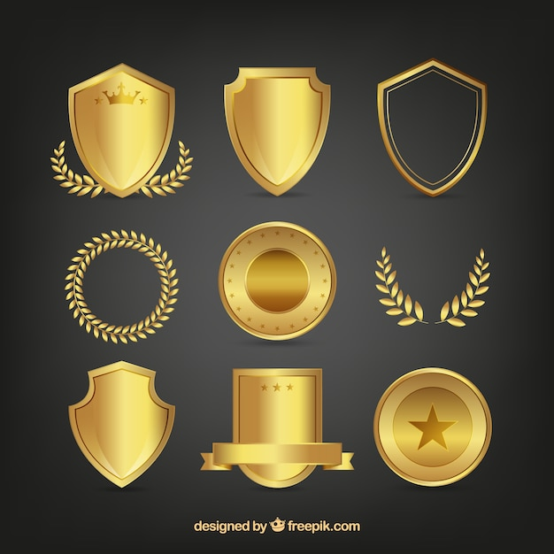 Set of golden shields and laurel wreaths Free Vector