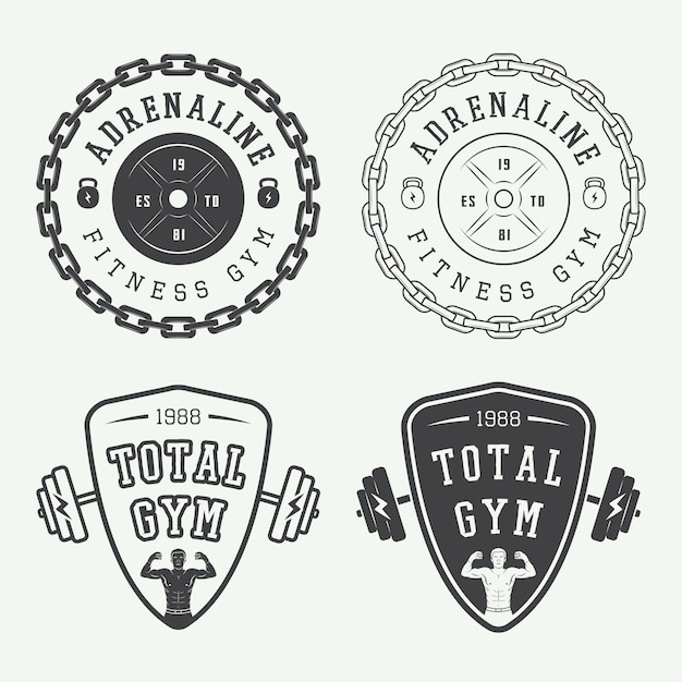 Set of gym logos, labels and badges in vintage style Premium Vector