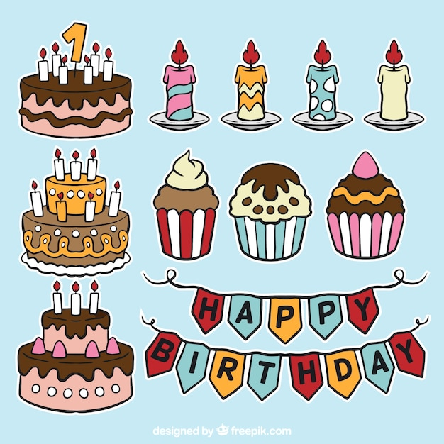 Set of hand drawn birthday cakes and candles Free Vector