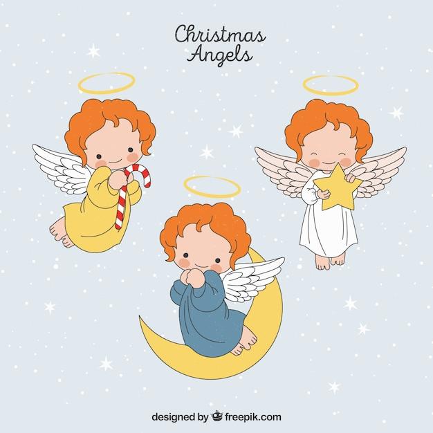 Set of hand drawn christmas angels Free Vector