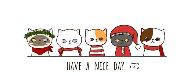 Set di gatti svegli di doodle disegnato a mano che indossano il costume di natale con scritte Vettore gratuito