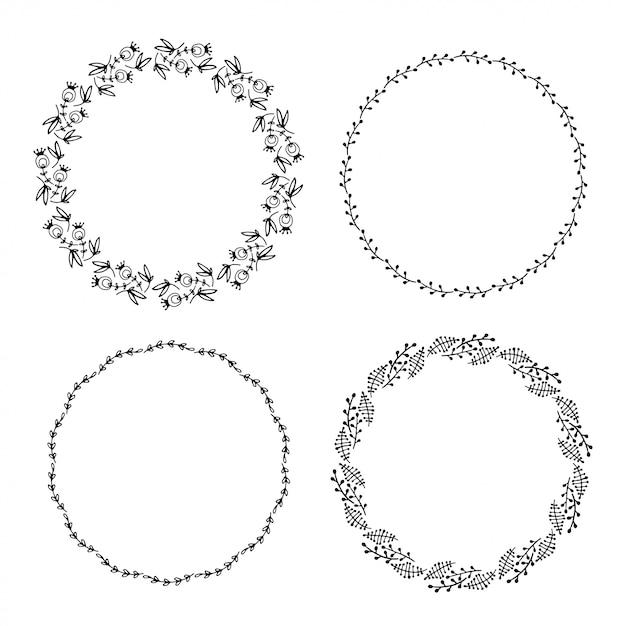 Set of hand drawn doodle floral frames. Premium Vector