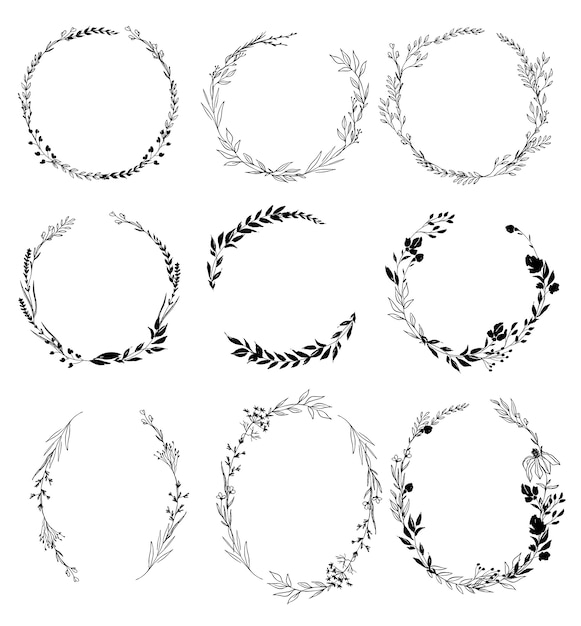 Set of hand drawn ink floral wreaths Premium Vector