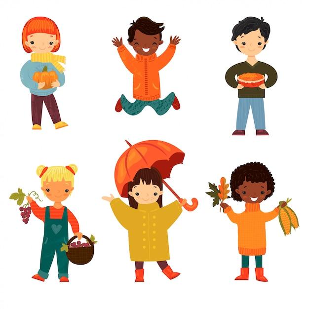 Set of happy smiling children of diverse ethnicities and genders in autumn Premium Vector