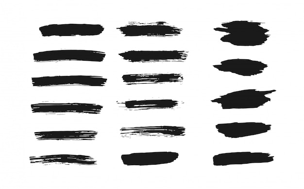 Set of isolated black thick ink brush strokes Premium Vector