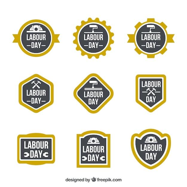 Set di etichette festa del lavoro con cornici gialle Vettore gratuito
