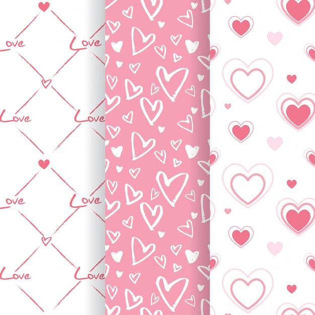 Set of lovely pink heart shape seamless patterns Premium Vector