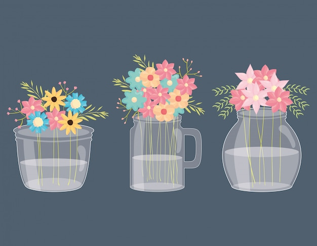 Set of mason jars with floral decoration Premium Vector