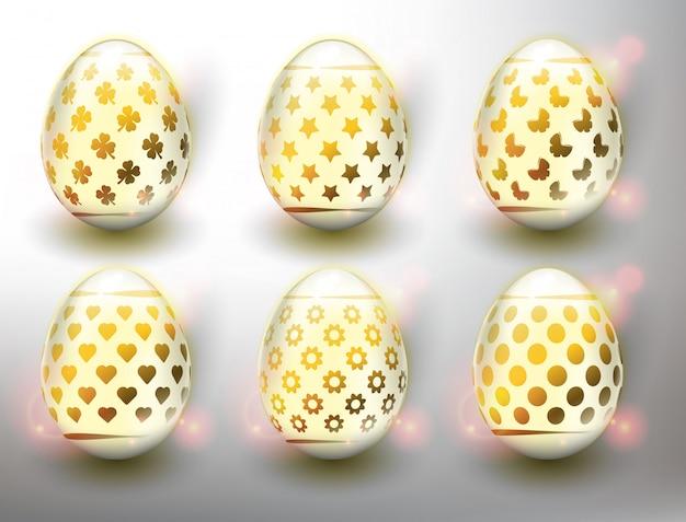 Набор из 6 цветных пасхальных яиц. пастельные цвета пасхальные яйца с золотым дизайном. изолированный на белой панели. Premium векторы