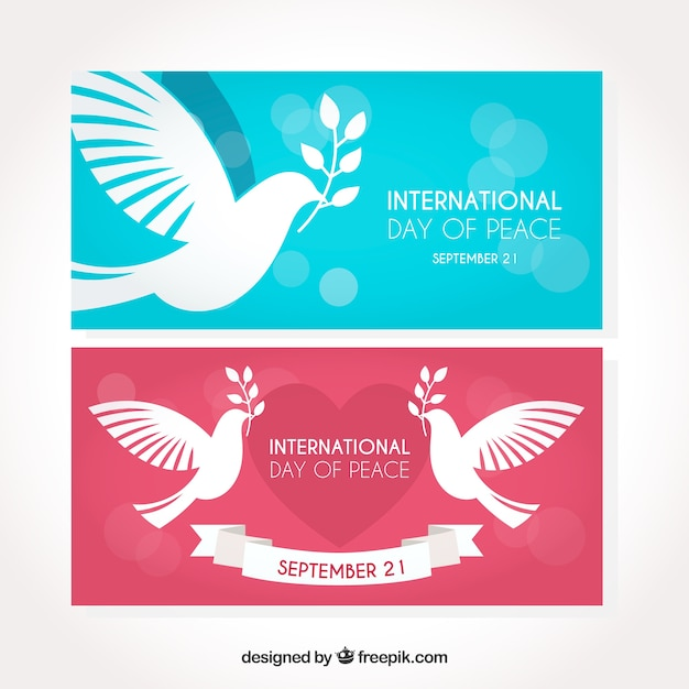 Set of banners with flat colorful doves
