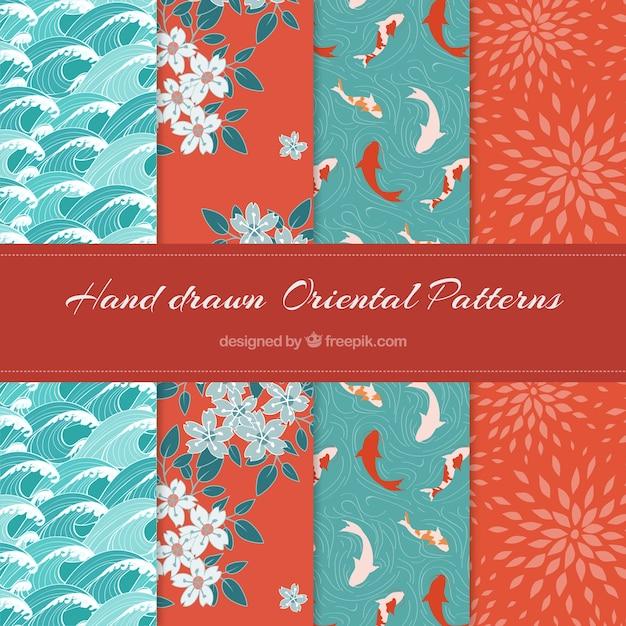美しい手のセット東洋のパターンを描画されました 無料ベクター