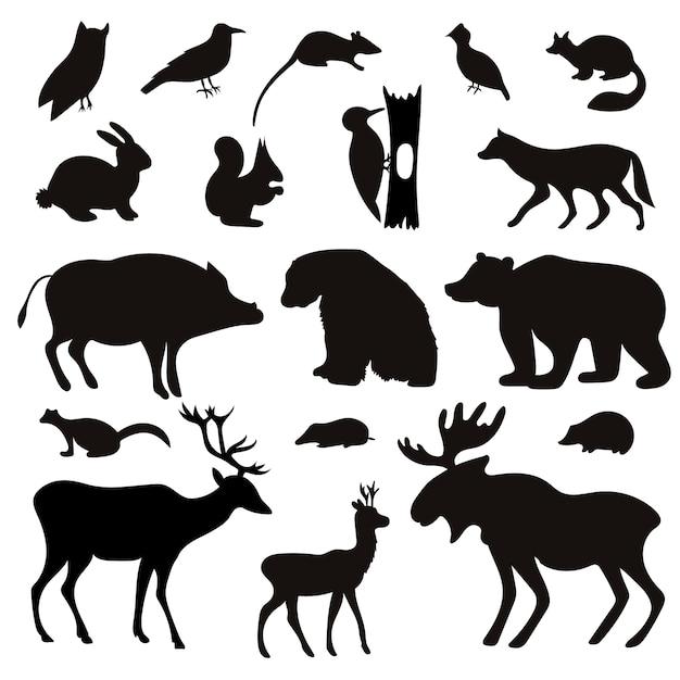Набор силуэтов черных тропических животных и птиц. Premium векторы