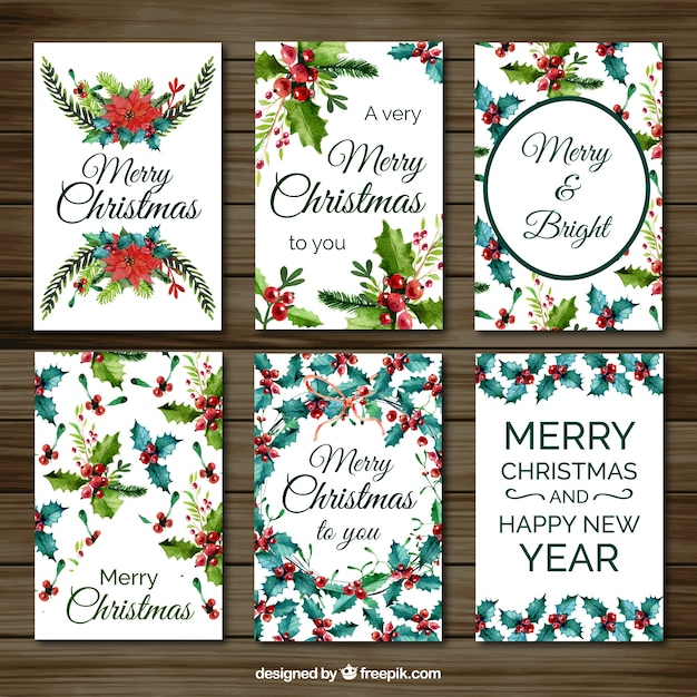 Set of christmas cards with watercolor mistletoe Free Vector
