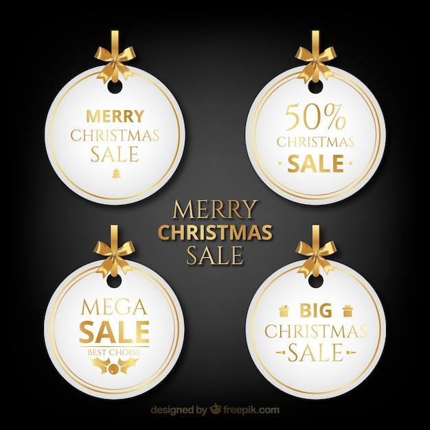 Set of christmas sale tags Free Vector