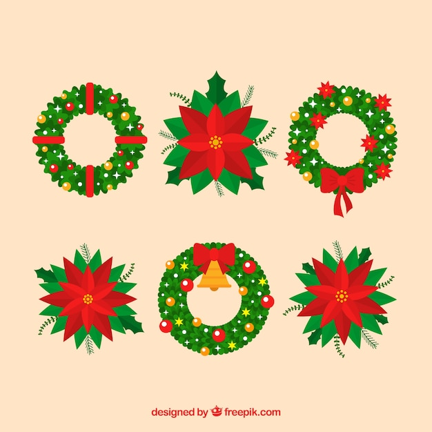 Set of christmas wreaths and poinsettias Free Vector