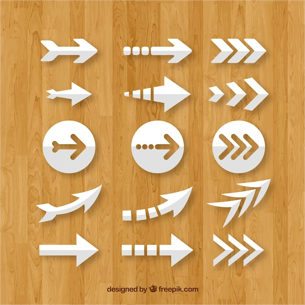 Set of colorful arrows to mark in flat style Free Vector
