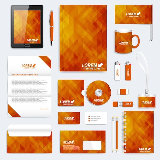 オレンジ色の幾何学模様の企業の文房具や事務用品のセット Premiumベクター