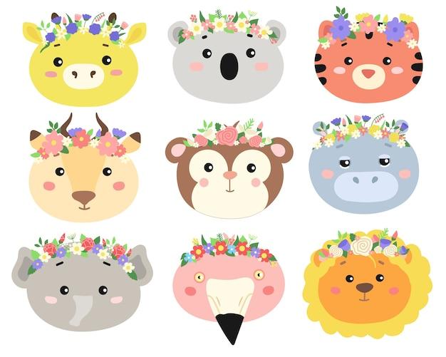 Набор милых голов животных с цветочными венками. Premium векторы