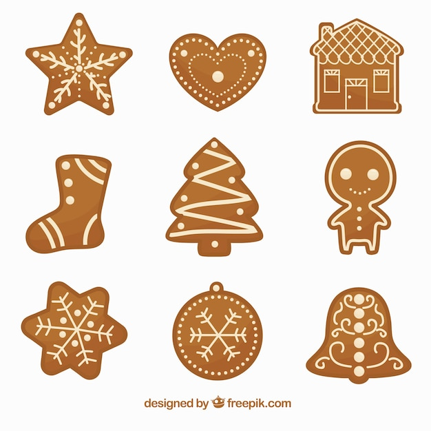 Set of delicious and decorative gingerbread cookies Free Vector