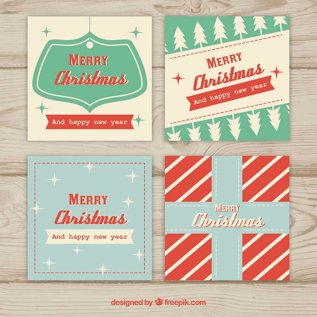 Set Of Four Christmas Cards In Vintage Design Free Vector