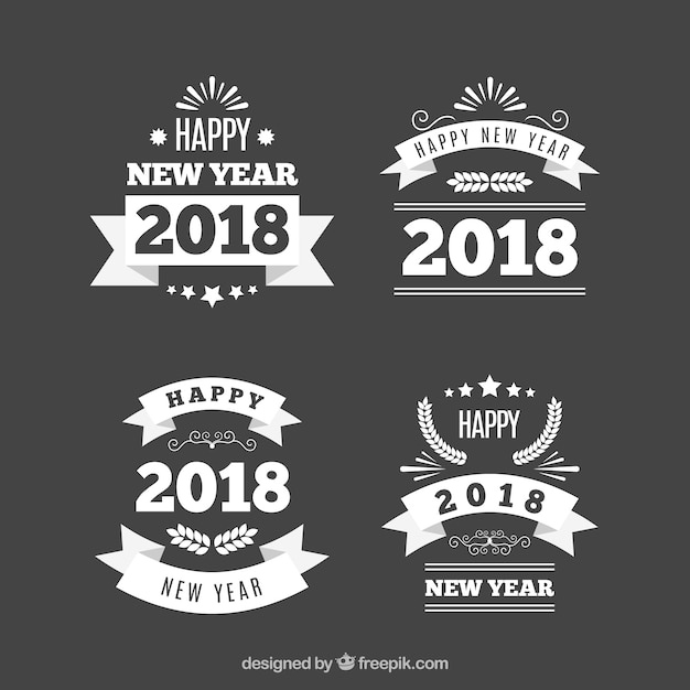 set of four vintage new year badges free vector