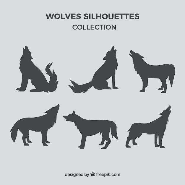 灰色のオオカミのシルエットのセット 無料のベクター