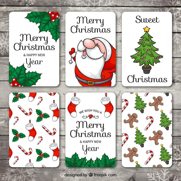 Set of hand drawn christmas and new year cards Free Vector