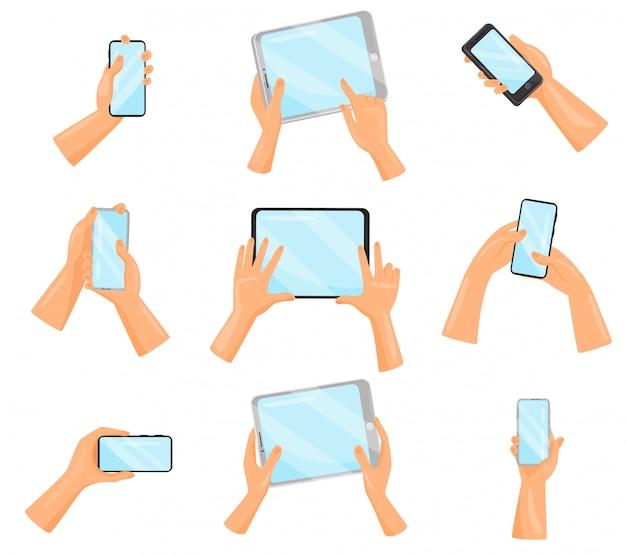 スマートフォンやタブレットコンピューターで人間の手のセットです。電子ガジェット。デジタル機器 Premiumベクター